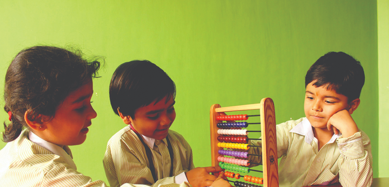 student solving problem using abacus device ITM Global School